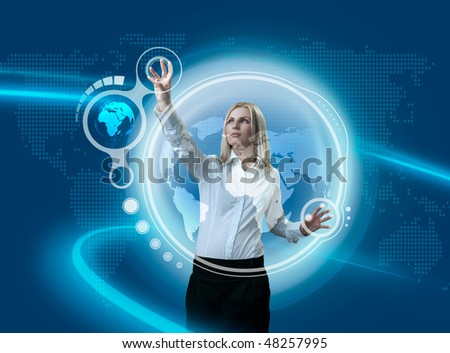 Future Globe Interface Navigating By Attractive Blonde (outstanding business people in interiors / interfaces series) - stock photo