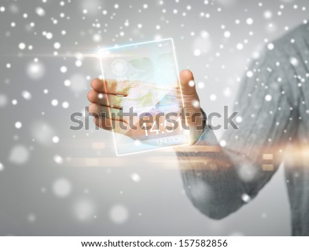 future, modern technology, new gadgets concept - man holding transparent phone or tablet pc - stock photo