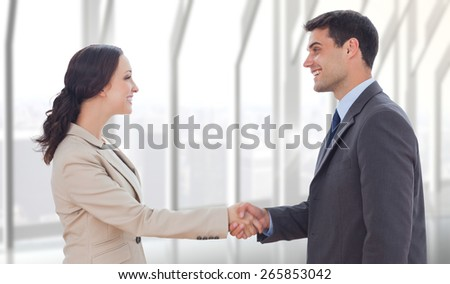 Future partners shaking hands against room with large window looking on city - stock photo