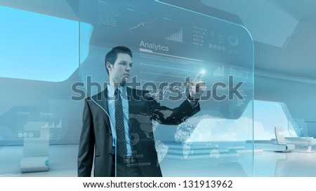 Future technology touchscreen interface. Man touching screen interface in hi-tech interior. Businessman  drawing chart in futuristic office. - stock photo