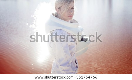 futuristic astronaut without a helmet on another planet, image with effect bright glare of sun - stock photo