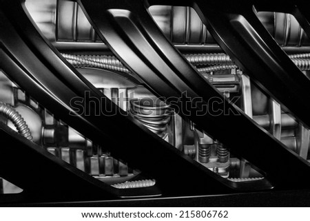 futuristic engine detail in black and white - stock photo