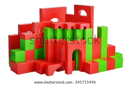 Futuristic house with natural colored toy blocks on white isolated background