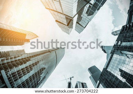 futuristic landscape of silhouettes of skyscrapers in the city. toning image. Focus on the tops of skyscrapers - stock photo