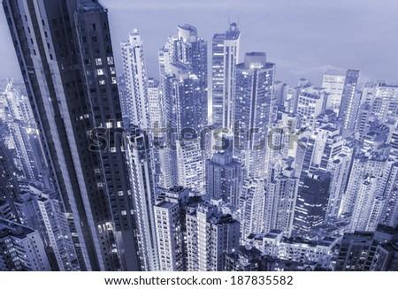 Futuristic mega city skyscrapers in a blue color tone.  - stock photo