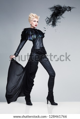 futuristic model like a bird and a raven made of dark smoke on a white platfrom - stock photo