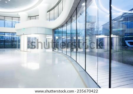 futuristic modern office building interior in urban city  - stock photo