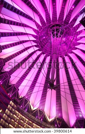 futuristic roof of commercial center at the Potsdamer Platz in Berlin lit by violet light, Germany - stock photo
