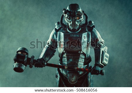 Futuristic soldier in steel armor with the cyber punk hummer.