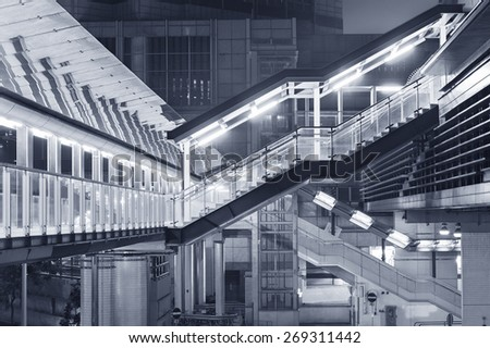 Futuristic stairway and pedestrian walkway in new modern building - stock photo