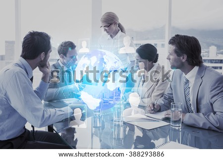 Futuristic technology interface against business people in board room meeting - stock photo