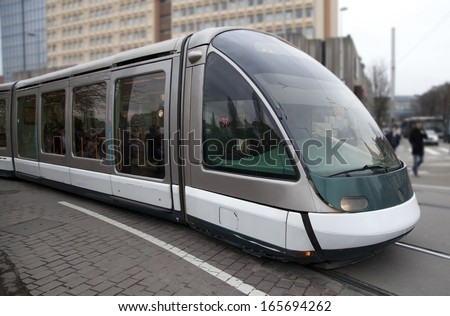 Futuristic tram on the street in Strasbourg, France - stock photo