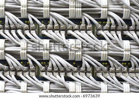 Futuristic white ethernet cables background. Fine technologycal texture.