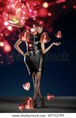 Futuristic woman with hearts for saint valentine day - stock photo