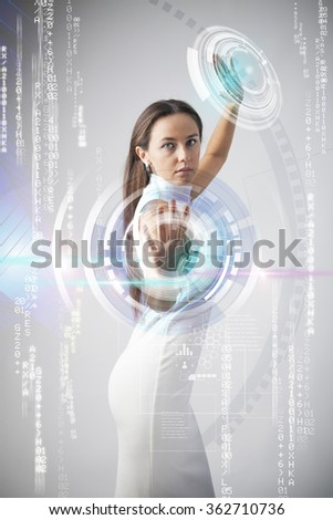 Futuristic woman working with virtual touchscreens - stock photo