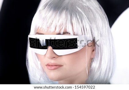 futuristic young woman wearing glasses - stock photo