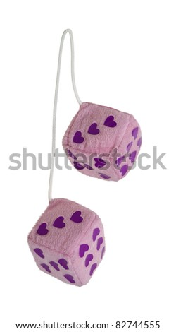 Fuzzy pink heart dice that are usually hung from the rear view mirror of a car - path included - stock photo