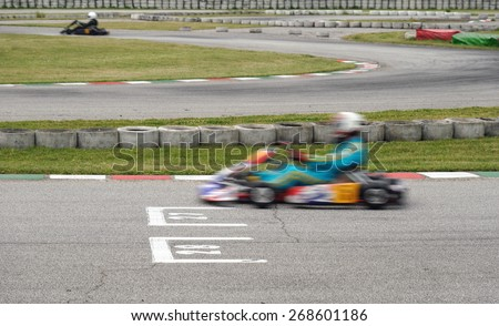 ga kart in race in the circuit - stock photo