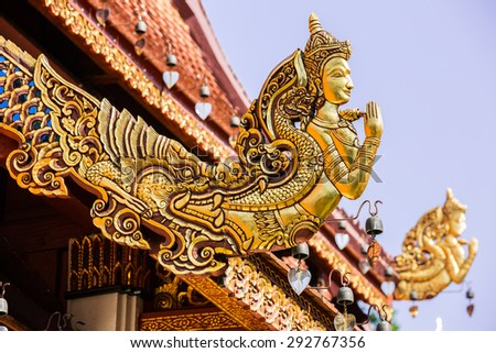 Gable End of Temple Roof, the saluting angle out of mouth of Naga, Wat Phra Sing - Chiang Rai, Thailand - stock photo