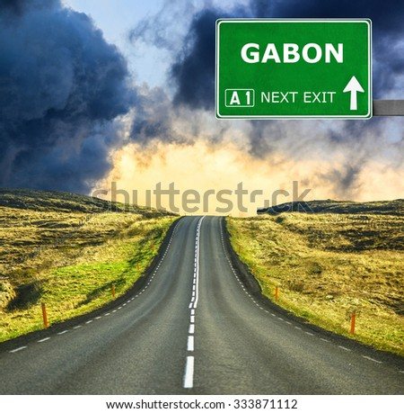 GABON road sign against clear blue sky