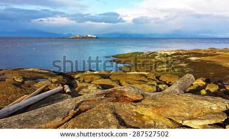 Gabriola Island and the Entrance Island Lighthouse, shot at sunset, in British Columbia, Canada. - stock photo