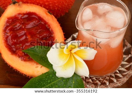 Gac fruit and juice isolated on white, with anti-oxidants and have many medicinal properties.