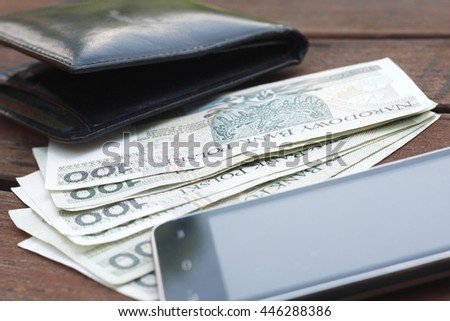 gadgets of modern man- cell phone, money in your wallet.