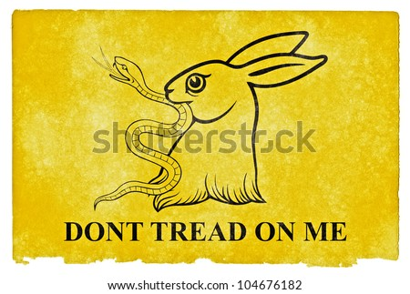 Gadsden Flag Parody on grunge textured vintage paper. Designed especially for comic relief where the fierce snake associated with the original Gadsden Flag ends up in the mouth of a cute bunny - stock photo