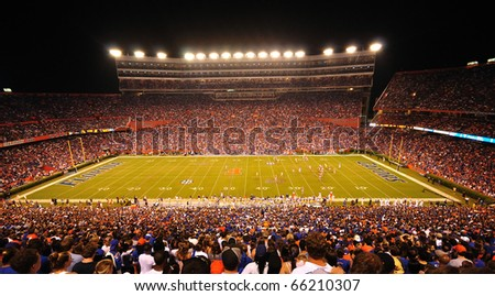 GAINESVILLE, FL - OCTOBER 9: More than 88,000 people attend the UF home game as the Gators host the LSU Tigers in Ben Hill Griffin Stadium in a SEC football match on October 9, 2010 at Gainseville, FL - stock photo