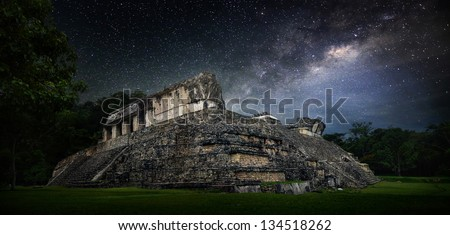 Galactic night starry sky over the ancient Mayan city of Palenque in Mexico. - stock photo