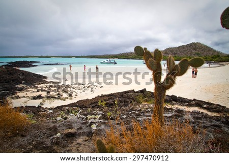 GALAPAGOS, ECUADOR - JULY 21, 2010: Unidentified tourists enjoying sunny day at beautiful deserted Garrapatero beach in Santa Cruz island, Galapagos - stock photo