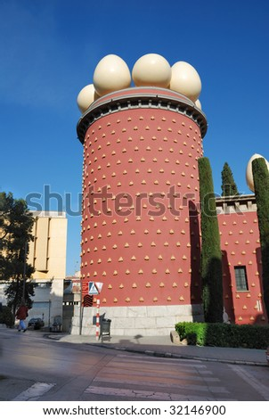 Galathea's tower with huge eggs against clear blue sky. Bottom view of empty street going by in sunny day. - stock photo