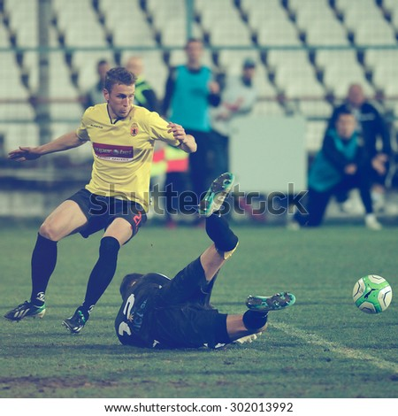 GALATI, ROMANIA - APRIL 6: Unknown football players performs during the soccer game in Liga 1, score 1-1, Otelul Galati vs. Ceahlaul Piatra Neamt on April 6, 2014 in Galati, Romania - stock photo