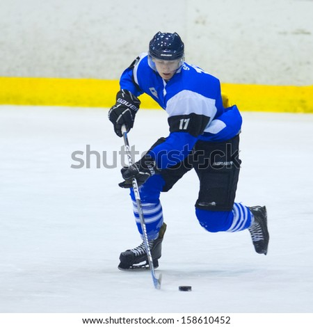 GALATI, ROMANIA - NOVEMBER 17: Unidentified hockey player from CSM Dunarea Galati during the CSM Dunarea Galati vs CSS HSC Csikszereda game, score 10-1, on November 17 , 2012 in Galati, Romania - stock photo