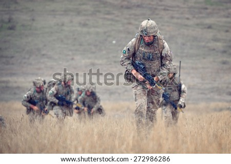 GALATI, ROMANIA - OCTOBER 8: British infantry in Romanian military polygon in the exercise Smardan Danube Express 14 on Galati, Romania, 8 october 2014. - stock photo