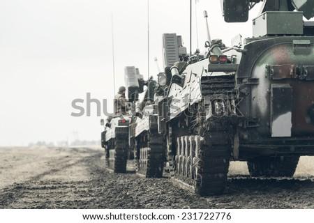 GALATI, ROMANIA - OCTOBER 8: Romanian infantry combat vehicles M84 ''JDER'' 100mm in Romanian military polygon in the exercise Smardan Danube Express 14 on Galati, Romania, 8 october 2014. - stock photo
