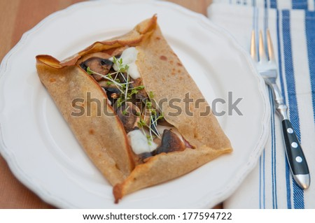 Galette de sarasin - french buckwheat crepe with mushrooms and cheese - stock photo
