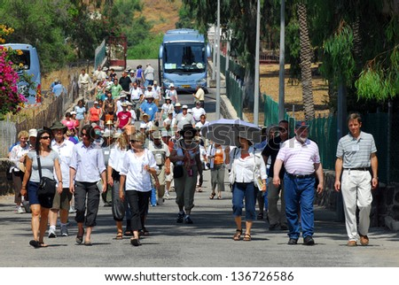 GALILEE,ISRAEL - MAY 19:Pilgrims arrive to Capernaum on May 19 2009.It was a Jewish fishing village and it said to be the home of St Peter and where Jesus healed a paralytic.