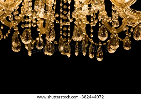 Gallant chandelier with black background and bottom copyspace. Luxury candelabra hanging on ceiling with lots of little gems.