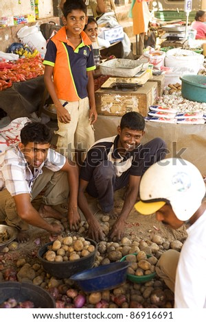 GALLE, SRI LANKA - FEBRUARY 13: Traditional street market on Fabruary 13, 2011 in Galle, Sri Lanka. Street market is the component of traditional Sri Lankan culture. - stock photo