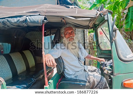 GALLE, SRI LANKA - MARCH 30: Unidentified tuctuc driver on the street of Galle, Sri Lanka at March 30, 2014. Tuktuks are an essential form of urban transport in Sri Lanka. - stock photo