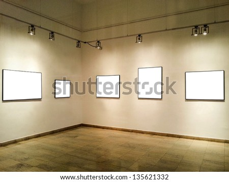 Gallery interior with blank frames - stock photo