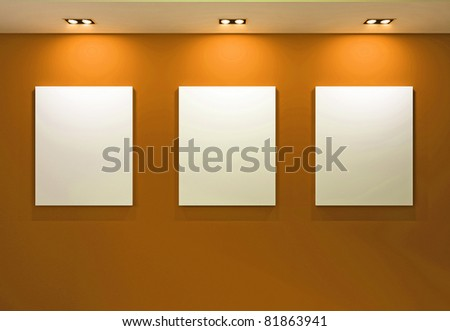 Gallery Interior with empty frames on orange wall - stock photo