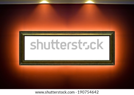 Gallery Interior with empty frames on red wall  - stock photo