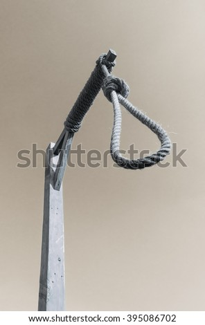 Gallows and hangman noose against a dark sky - stock photo