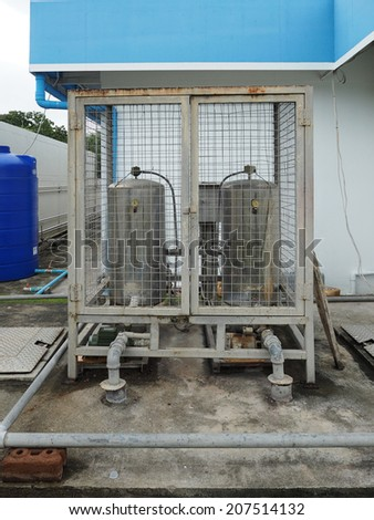 Galvanized steel pipe and tank, water piping system - stock photo