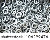 Galvanized steel spring washers, a shop floor item - stock photo