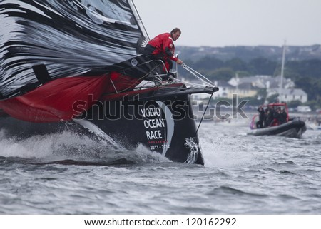 GALWAY, IRELAND - JULY 7: Casey Smith on foredeck of PUMA Ocean Racing's Mar Mostro during In-port race of 2011-2012 Volvo Ocean Race finish in Galway, Ireland on July 7, 2012 - stock photo