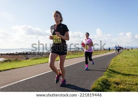 GALWAY, IRELAND - OCTOBER 4: Unidentified athletes compete during annual Galway Bay Half Marathon and 10K, on October 4, 2014 in Galway, Ireland. - stock photo