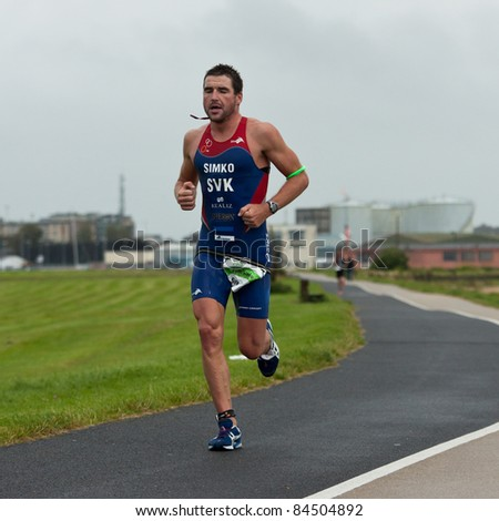 GALWAY, IRELAND - SEPT 4: Pavel Simko (7), II place, compete at first Edition of Iron Man Triathlon on September 4, 2011 in Galway, Ireland - stock photo